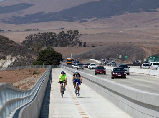 two bikers on a bike path in SLO