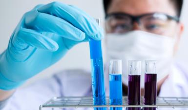 Lab tech looking at vials