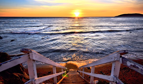 stairs leading to beach at sunset