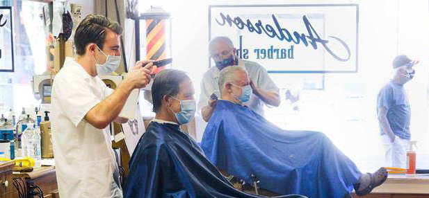 Barbers and customers wearing masks